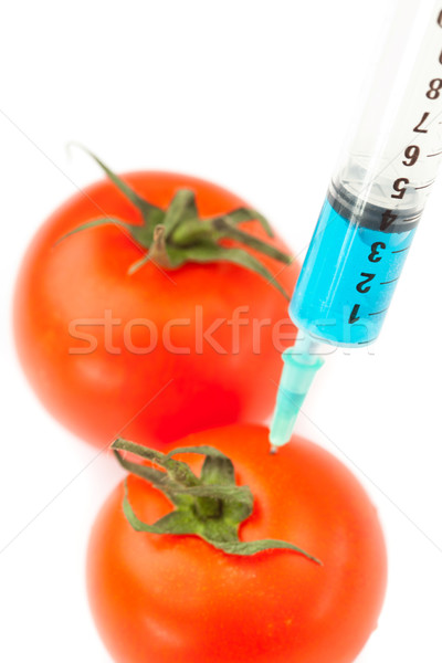 Jeringa tomate blanco medicina azul laboratorio Foto stock © wavebreak_media