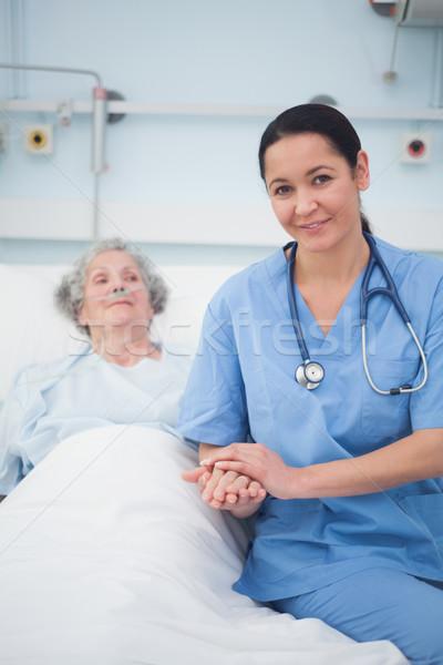 медсестры сидят кровать пациент больницу стороны Сток-фото © wavebreak_media