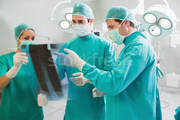 Close up of a surgical team analysing a X-ray in an operating theatre Stock photo © wavebreak_media