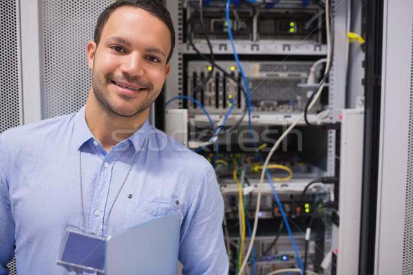 男 笑みを浮かべて 立って データ サーバー サーバー ストックフォト © wavebreak_media
