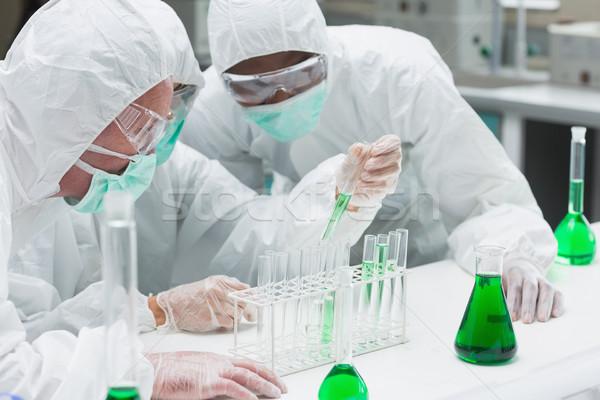 Kettő zöld folyadék laboratórium nő iroda Stock fotó © wavebreak_media