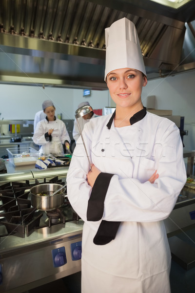 Giovani femminile chef mestolo cucina Foto d'archivio © wavebreak_media