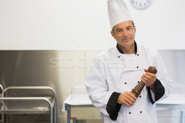 Chef holding a pepper mill while smiling Stock photo © wavebreak_media