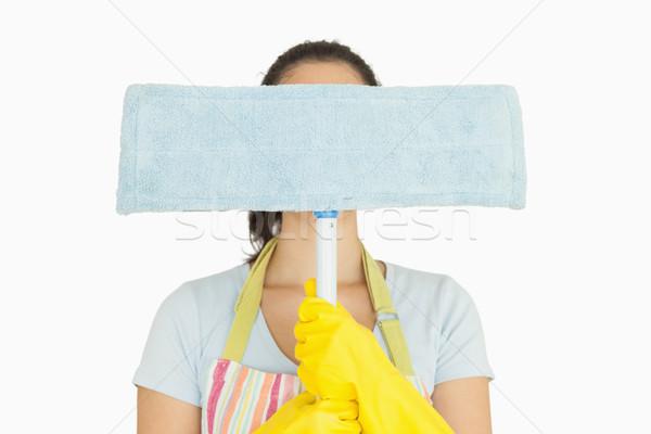 Donna grembiule guanti di gomma nascondere dietro femminile Foto d'archivio © wavebreak_media