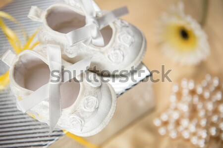 Baptism candle and baby booties Stock photo © wavebreak_media