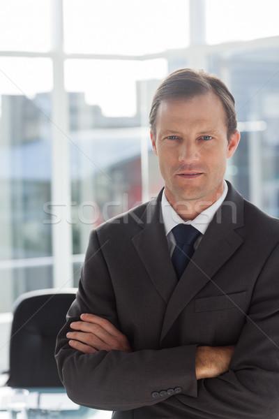 Confident businessman with arms folded Stock photo © wavebreak_media