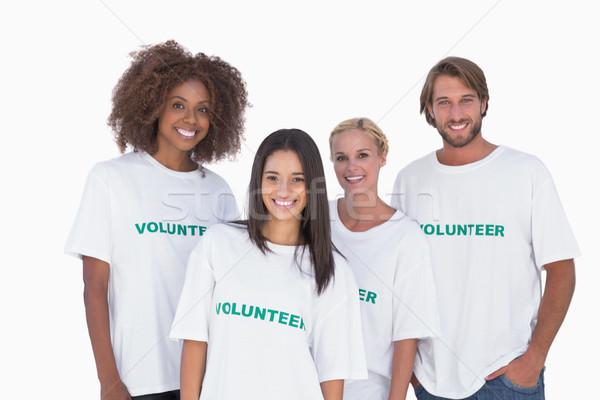 Boldog csoport önkéntesek fehér csapat fekete Stock fotó © wavebreak_media