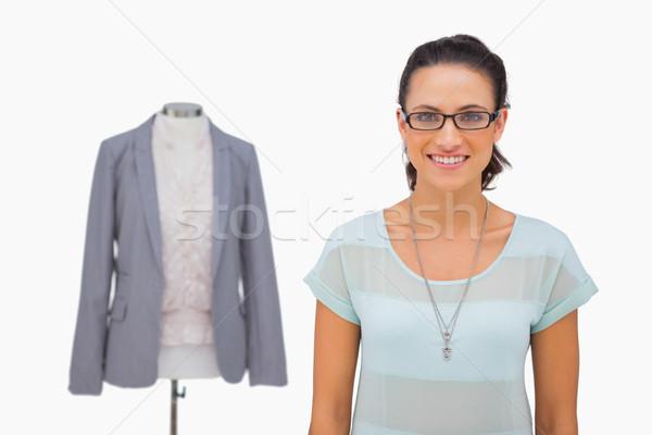 Designer smiling at camera with mannequin behind Stock photo © wavebreak_media