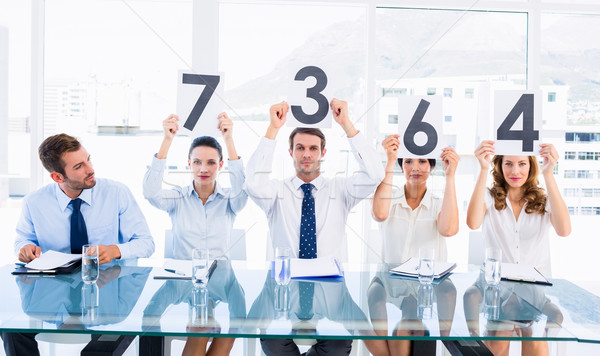 Group of panel judges holding score signs Stock photo © wavebreak_media