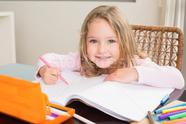 Happy little girl colouring at the table Stock photo © wavebreak_media