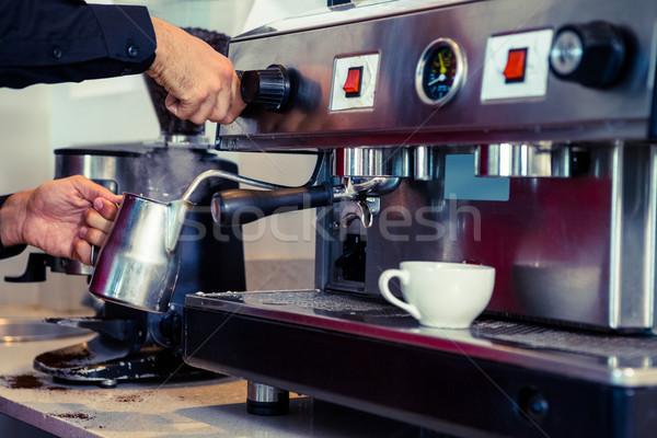 Barista steaming milk at the coffee machine Stock photo © wavebreak_media