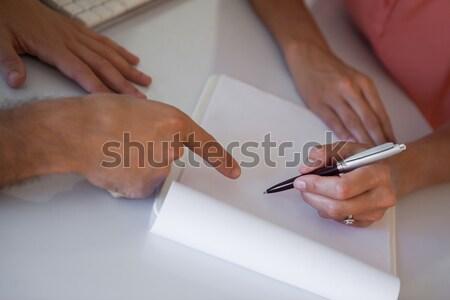 Therapist taking notes on clipboard Stock photo © wavebreak_media