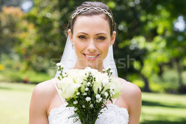 Bride with flower bouquet smiling in garden Stock photo © wavebreak_media
