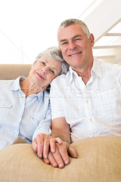 Gepensioneerd paar holding handen bank glimlachend camera Stockfoto © wavebreak_media