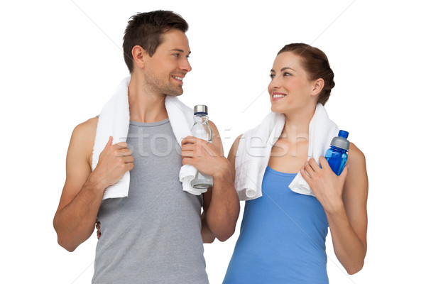Happy fit young couple with water bottles Stock photo © wavebreak_media