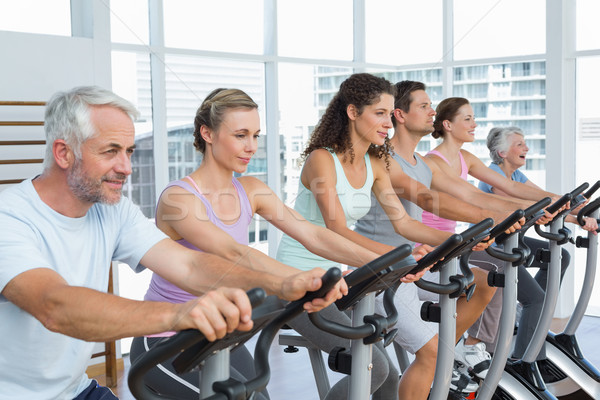 Determined people working out at spinning class Stock photo © wavebreak_media