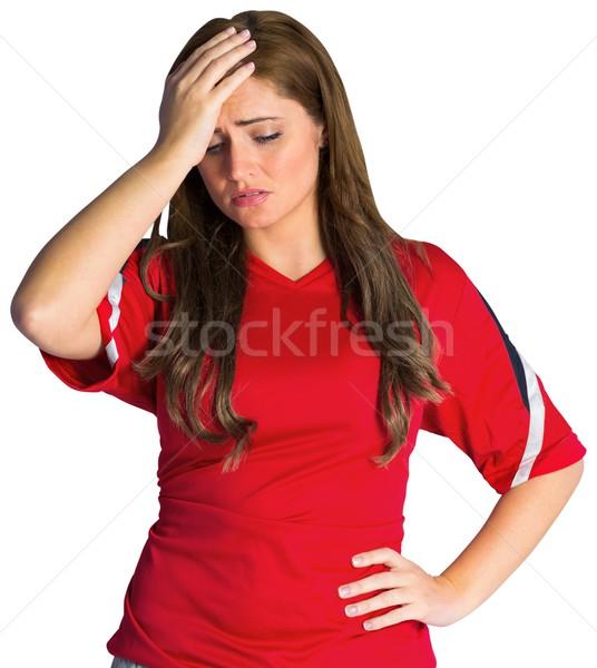 Disappointed football fan looking down Stock photo © wavebreak_media