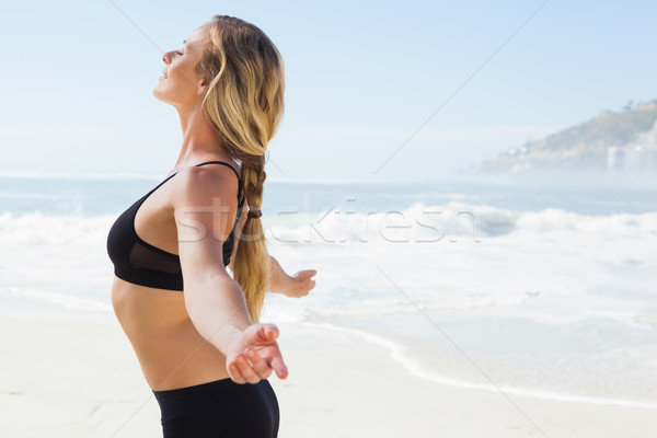 Fit blonde standing on the beach with arms outstretched Stock photo © wavebreak_media