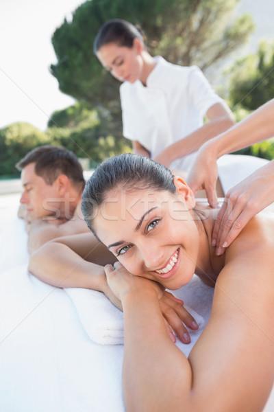 Attractive couple enjoying couples massage poolside Stock photo © wavebreak_media