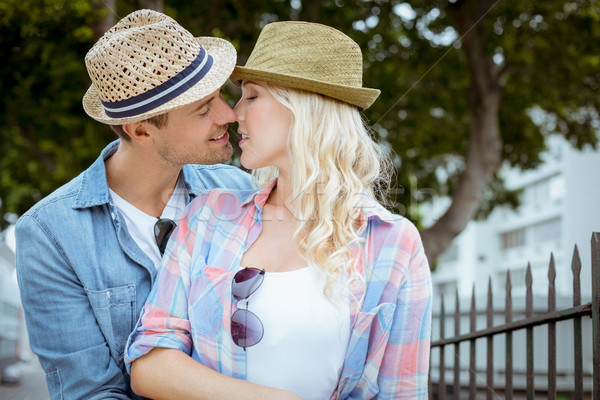 Hip young couple kissing by railings Stock photo © wavebreak_media