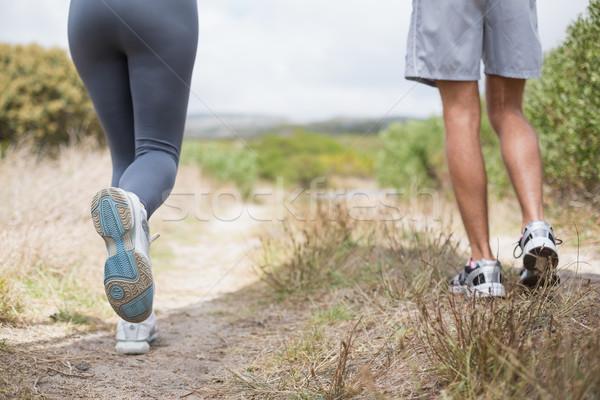 Fitt pár jogging hegy nyom napos idő Stock fotó © wavebreak_media