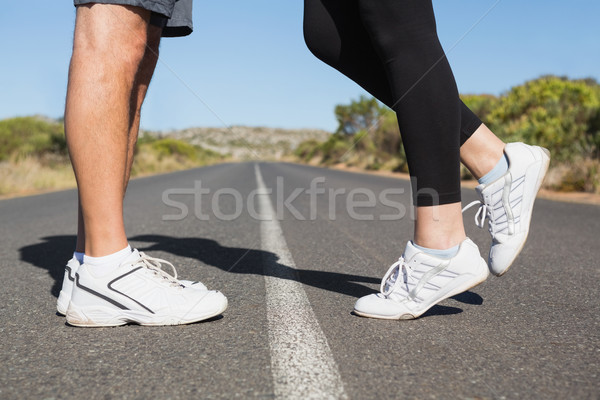 Fit couple standing on the open road together Stock photo © wavebreak_media