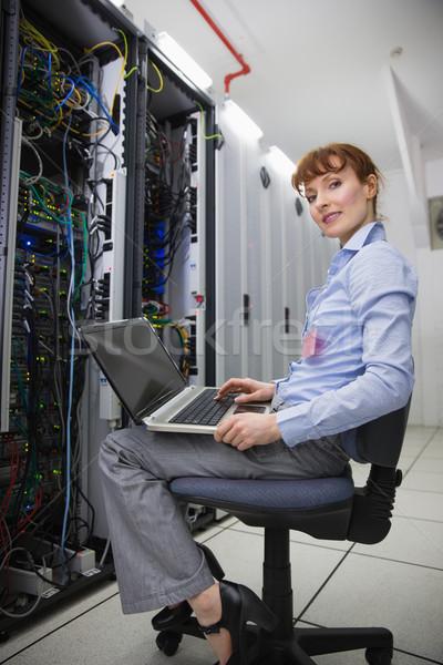 Boldog technikus ül szék laptopot használ diagnózis Stock fotó © wavebreak_media