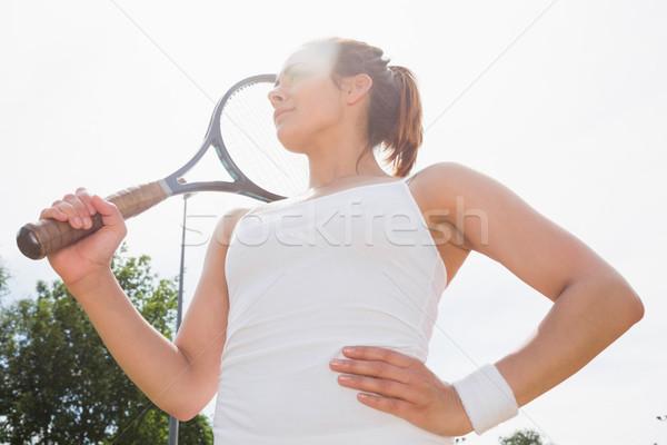 Pretty tennis player holding racket Stock photo © wavebreak_media