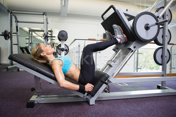 Side view of fit woman doing leg presses in gym Stock photo © wavebreak_media