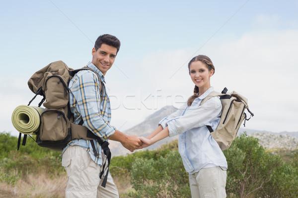 походов пару , держась за руки горные местность портрет Сток-фото © wavebreak_media