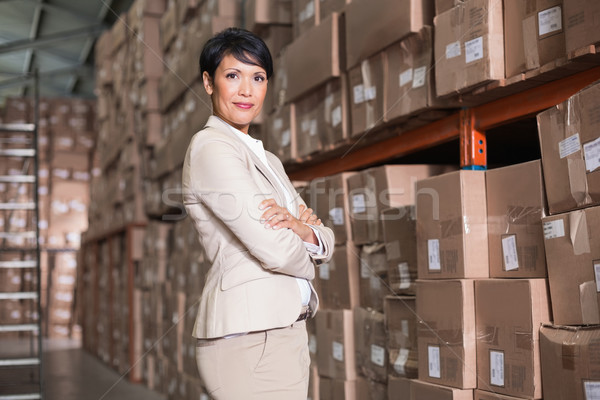 Pretty warehouse manager smiling at camera Stock photo © wavebreak_media