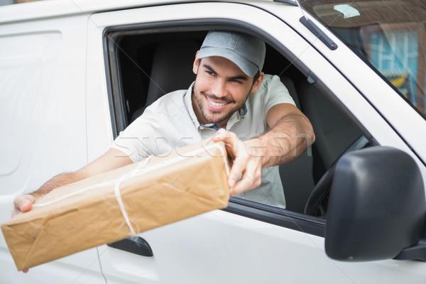 Delivery driver offering parcel from his van Stock photo © wavebreak_media