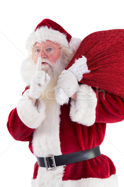 Santa asking for quiet with bag Stock photo © wavebreak_media