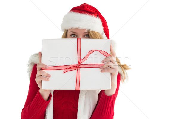 Blonde woman hiding behind a gift Stock photo © wavebreak_media