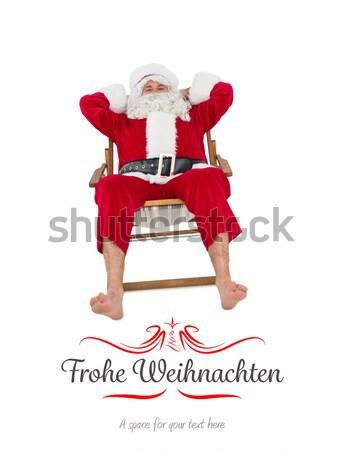 Happy santa relaxing on deckchair Stock photo © wavebreak_media