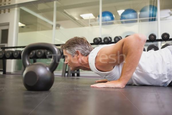 Caber homem exercício ginásio esportes corpo Foto stock © wavebreak_media