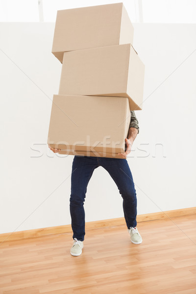 Férfi egyensúlyoz nehéz karton dobozok otthon Stock fotó © wavebreak_media