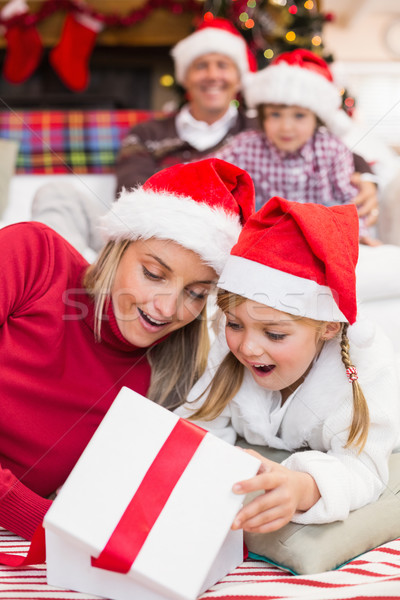 Surprised mother and daughter opening a christmas gift Stock photo © wavebreak_media