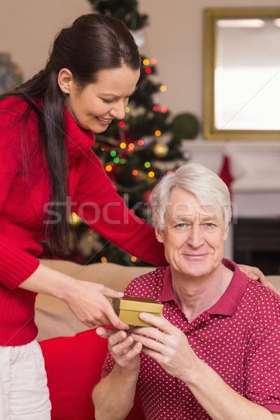 счастливым матери предлагающий подарок деда домой Сток-фото © wavebreak_media