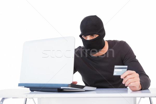 Scassinatore shopping online laptop carta di credito bianco uomo Foto d'archivio © wavebreak_media