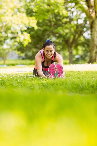 Fit brunette warming up on the grass Stock photo © wavebreak_media