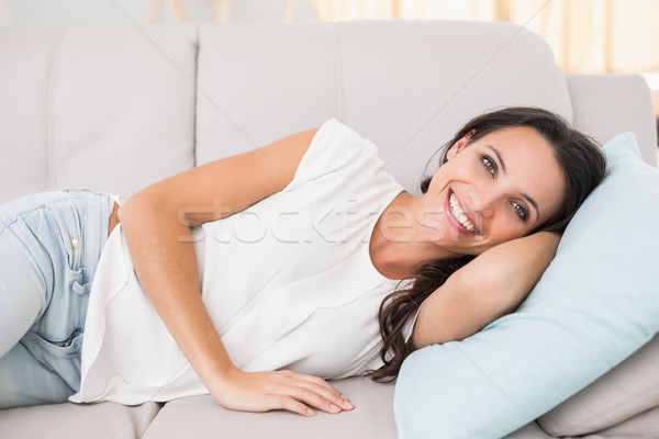 Stock photo: Pretty brunette lying on couch