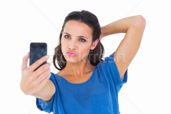Pretty brunette taking a selfie Stock photo © wavebreak_media