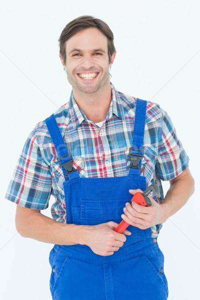 Confident plumber holding monkey wrench Stock photo © wavebreak_media