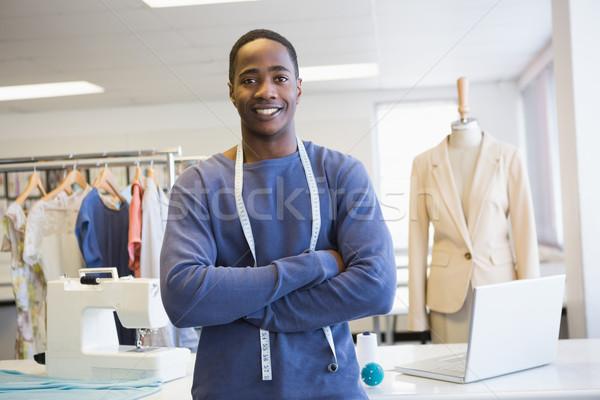 Smiling university student posing with arms crossed Stock photo © wavebreak_media