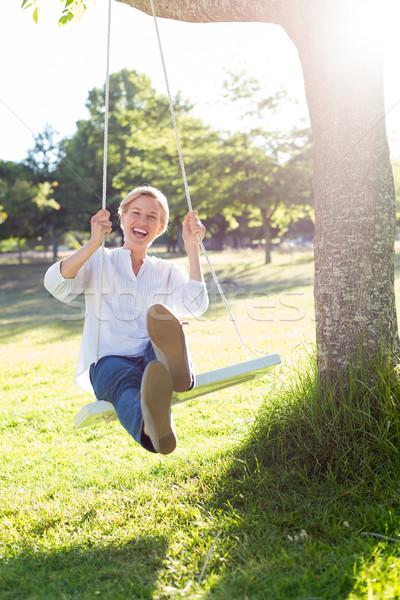 Mutlu salıncak kadın ağaç Stok fotoğraf © wavebreak_media