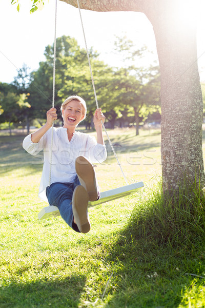 Glücklich Swing Frau Baum Stock foto © wavebreak_media