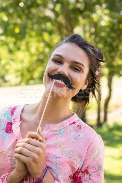 Mooie brunette namaak snor vrouw natuur Stockfoto © wavebreak_media