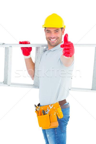 Sorridente handyman escada Foto stock © wavebreak_media