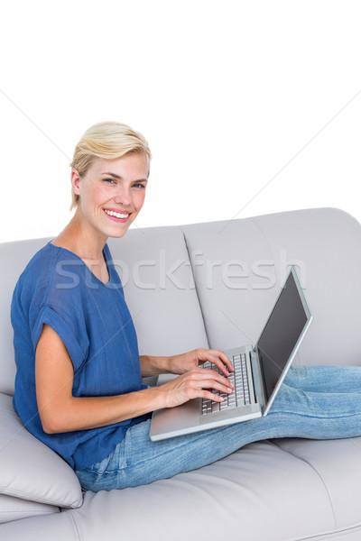 Sarışın kadın dizüstü bilgisayar kullanıyorsanız kanepe beyaz bilgisayar kadın Stok fotoğraf © wavebreak_media
